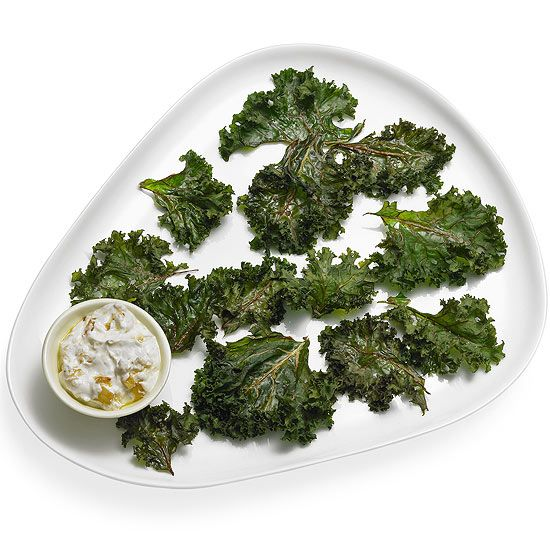 Bake vitamin-packed #kale into chips, then serve them with our onion dip—research has found that little ones are 80% more likely to eat #vegetables when they can dunk them. Recipe: http://www.parents.com/recipes/nutrition/kids/vegetables-for-kids/?socsrc=pmmpin130610fKaleChips#page=5
