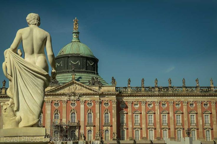 Statue and building façade of the Neues Palais or New Palace at Potsdam, Germany