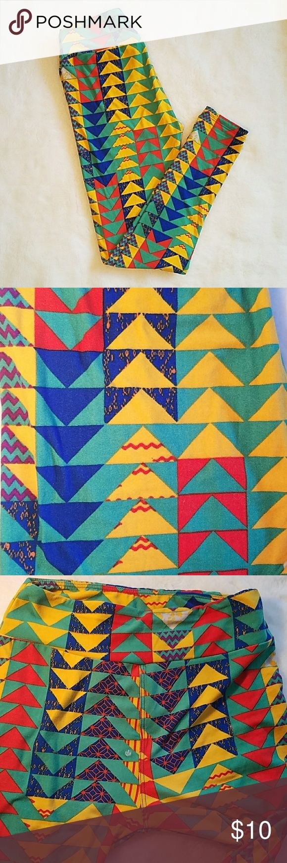 Lularoe triangle leggings These are super great condition except for the spot on the front if you wear a long shirt and no one will see it. It's like a hard glue spot I'm not sure how to get it out. Please make reasonable offer. lularoe  Pants Leggings