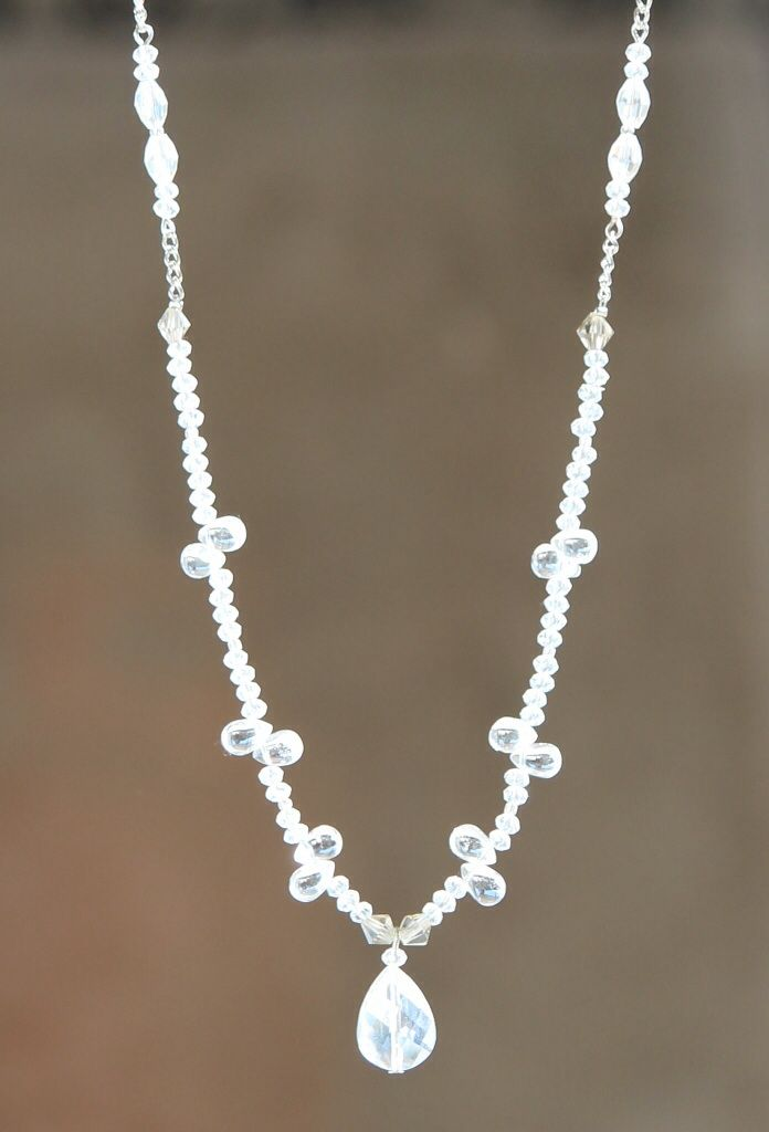 White beaded crystal drop necklace made by HeartBeads.   https://www.facebook.com/heartbeadsjewellery
