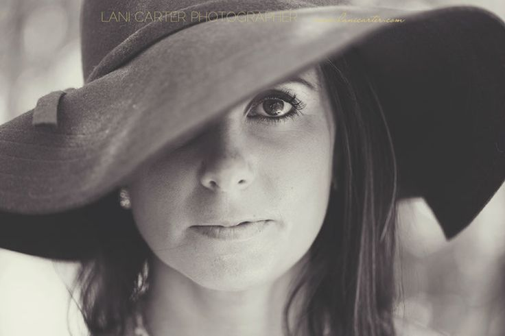 Black and white portrait of a woman wearing a hat that tilts over one eye. Lifestyle photography. www.lanicarter.com