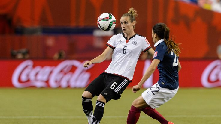 Simone Laudehr of Germany looks to play the ball near Amel Majri of France