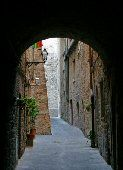 Tuscan Style Decorating: Natural stone forms a beautiful architectural arch.