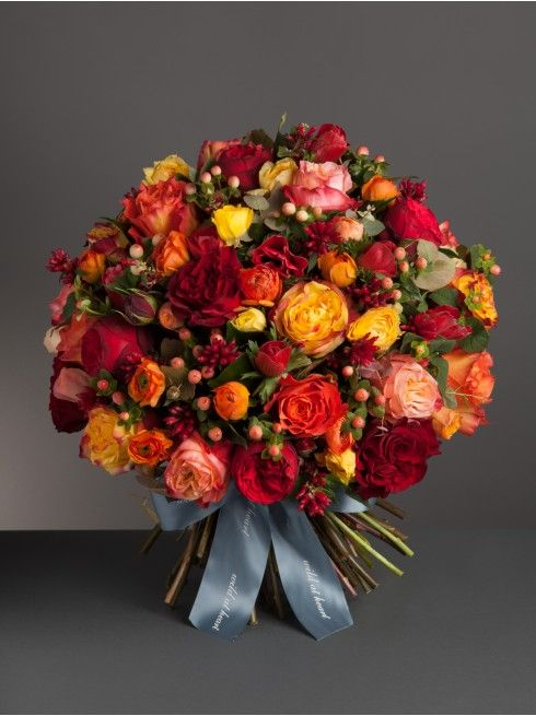 Wild At Heart - Nikki's Fiery bouquet  - This bouquet is a rich and decadent mix of roses, ranunculus, anemones, hypericum and mixed seaonal foliage