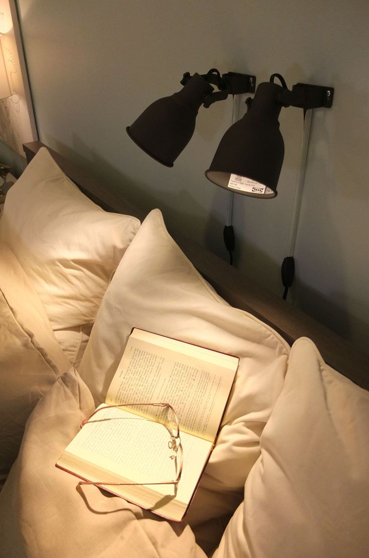 Installing individual HEKTAR lamps above the bed allows reading in bed without disturbing your partner.