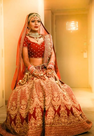 Bridal Wear - Red Bridal Lehenga with Golden Embroidery | WedMeGood #wedmegood #indianbride #indianwedding #lehenga #bridal #golden #embroidered #red #bride #bridaloutfit