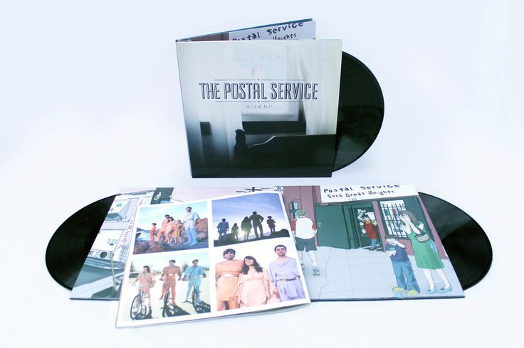 "You can spend all the time and money in the world trying to craft the perfect pop-music scenario, but sometimes the stars have to align all by themselves. Even though early on the members of The Postal Service jokingly referred to Such Great Heights as ""the hit"" on their debut album, Give Up, the..."
