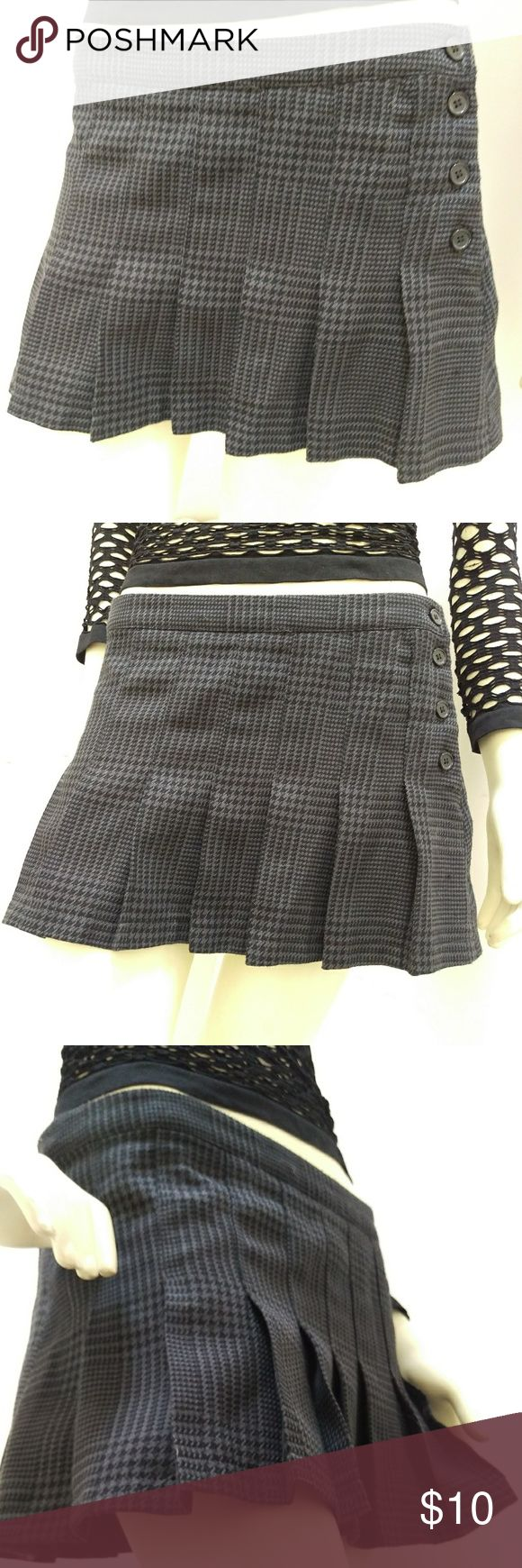 🆕✴Pleated Schoolgirl Style Mini - Miley Cyrus✴ .Super cute grey and black pleated schoolgirl style miniskirt  by Miley Cyrus and Max Azria (Bcbg) for Walmart.  Size Juniors 9 Shell 86% Polyester 14% Viscose Lining 100% Polyester Wash w/ like colors and line dry.  In excellent used condition. Only wore it a few times. Miley Cyrus & Max Azria Skirts