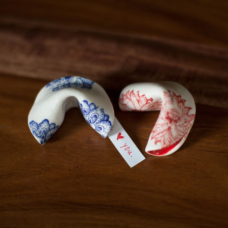 """Hand-crafted by Wisconsin-based artist Kim Oaks, these porcelain fortune cookies with elegant Chinese silkscreen patterns are the perfect way to convey something special to anyone you care about. Each beautifully glazed cookie includes 5 blank fortunes so you can say anything you want!  Details      Dimensions: Approx. 2.5"""""""