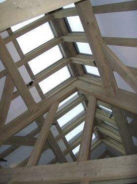 Ridge glazing to green oak barn house, by Roderick James Architects