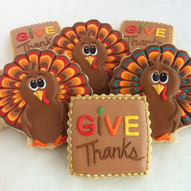 Thanksgiving decorated sugar cookies. Royal icing. Brown, yellow, red, orange, green. Turkey, sea shell, square cutter. Text. Give Thanks.