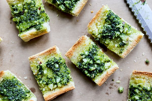 The vegan garlic bread is made with olive oil, lots of minced garlic and a thick layer of homemade kale pesto.
