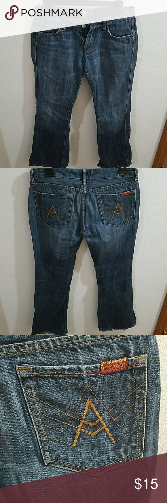 7 For All Mankind Size 27 Women's Jeans 7 For All Mankind Size 27 Women's Jeans. Have been loved and show some wear with wear to the bottom hems of legs. Not worn through but thinning on inner upper thigh. The inseam is about 30 inches in length. 5 pocket design with a classic 7 For All Mankind button closure. 7 For All Mankind Jeans