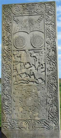 Pictish stones with 35 symbols, Replica of the Class II Hilton of Cadboll Stone at the original location - The Eassie Stone depicts ancient ceremonies and rituals.