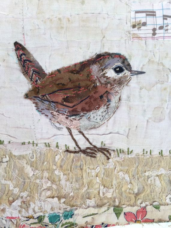 I treasure the old and worn and refashion them into little textile collages in my attic studio in a converted manse in Northumberland, England. Everything I make is individual and unique. This little wren is hand appliquéd and embroidered on to a support of an old patchwork quilt fragment. I have used some cotton fabrics for the appliqué and hand turned the edges. A very fiddly job! I have enhanced the appliqué with hand stitching.The collage is then sewn on to a piece of mount board to…