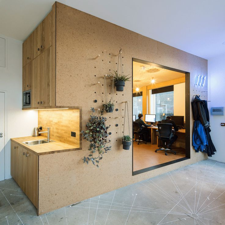 Selencky Parsons has designed its own London studio, using a cork pod with pegboard walls for storing stationery, displaying models and hanging plants