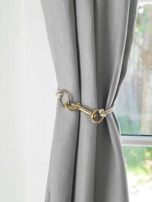 Love this idea from @Annie Compean Compean Selke: a frill- and drill-free way to corral drapes: Just combine a swiveleye snap hook, key ring, and cord.