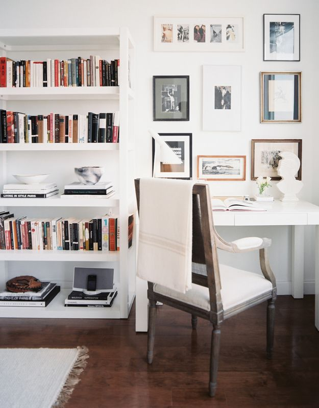 Beautiful white office space - love the bookcase next to desk