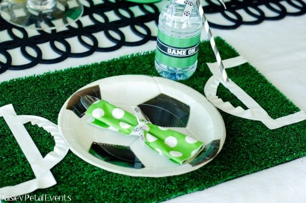 Placemats out of artificial lawn turf & white electrical tape to create a soccer field