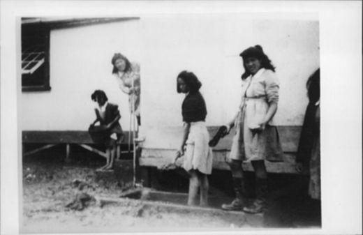 Panguru [St Joesph's ?] School. Cleaning out foot-bath. - Auckland War Memorial Museum Tamaki Paenga Hira