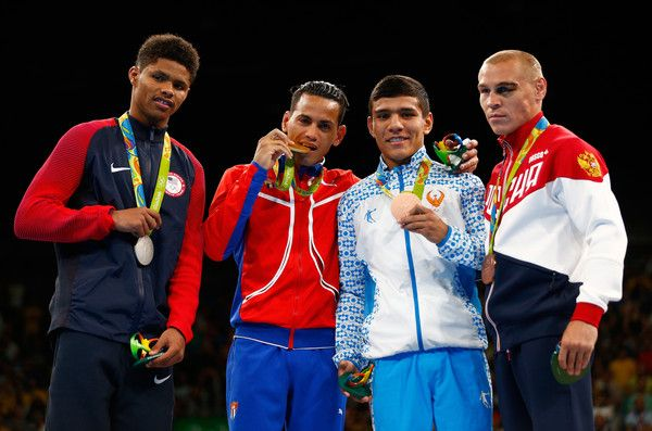 Silver medalist Shakur Stevenson of the United States, gold medalist Robeisy Ramirez of Cuba and bronze medalists Murodjon Akhmadaliev of Uzbekistan and Vladimir Nikitin of Russia pose during the medal ceremony for the Men's Bantam (56kg) on Day 15 of the Rio 2016 Olympic Games at Riocentro - Pavilion 6 on August 20, 2016 in Rio de Janeiro, Brazil.