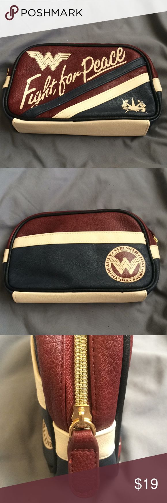 "WONDER WOMAN Make-Up bag Red, white and blue Wonder Woman make up bag. This zip-up bag features a ""Fight For Peace"" logo. Never used brand new. Officially licensed. Bags Cosmetic Bags & Cases"