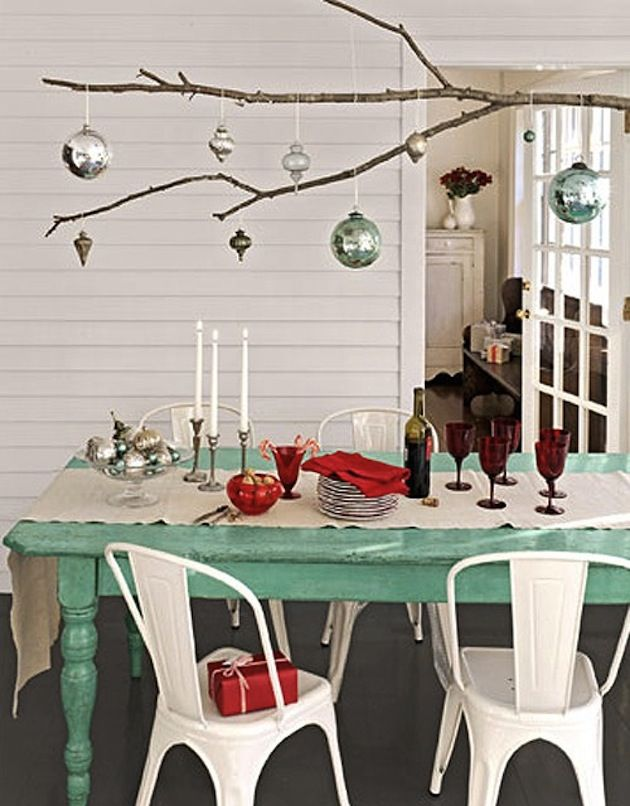 Stylish Christmas Table Ideas - I want to make a stick chandelier for ornaments above the tables