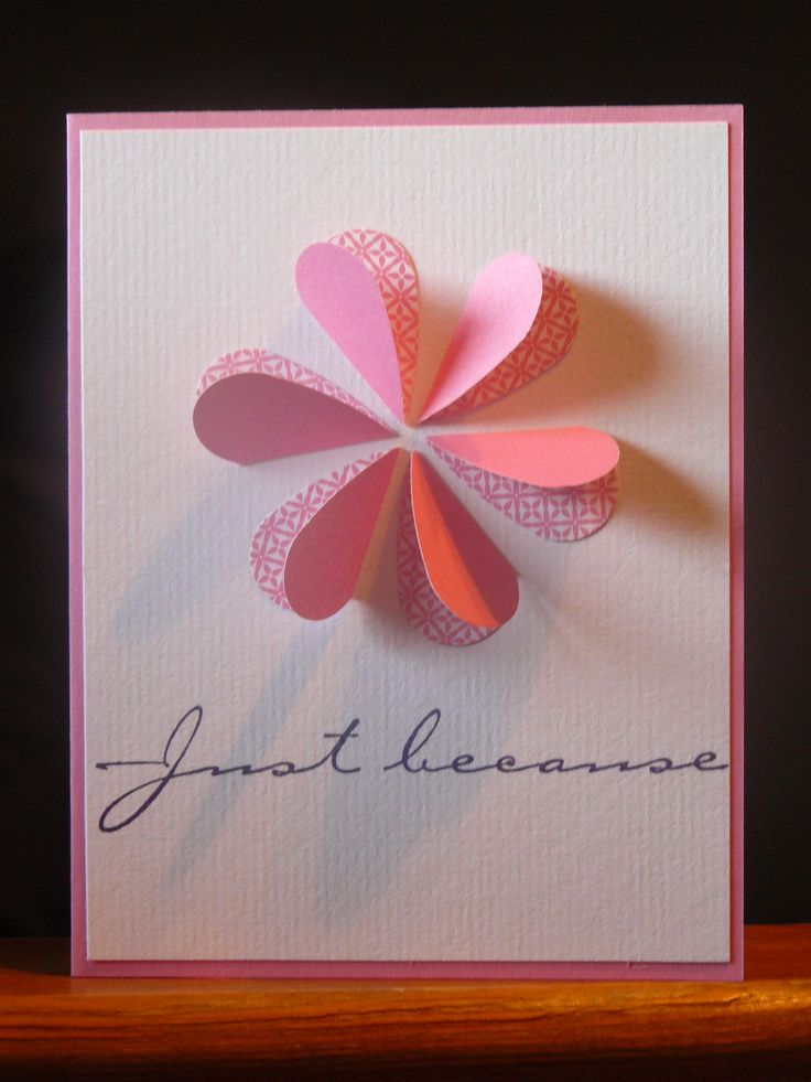 "Homemade greeting card made with pink cardstock for the base, white textured cardstock layered on front, double sided paper punched into about 1 inch hearts, folded in half, arranged into a flower, adhered with double sided tape.  The ""Just because"" is a Stampin' Up stamp.  Merry crafting!"