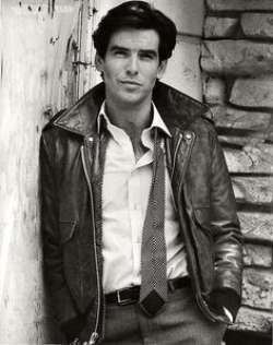 Young Pierce Brosnan in Leather Jacket and Buttondown Shirt