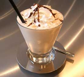 Coffee Cooler:    Ingredients:  1 ½ cups Wolfgang Puck Culinary Iced Coffee  1 ½ cups chocolate ice cream  ¼ cup chocolate syrup  Crushed ice  Whipped cream    Instructions:  1. Blend coffee, ice cream and syrup in a blender until the drink is smooth.  2. Pour over crushed ice  3. Top with a healthy helping of whipped cream.