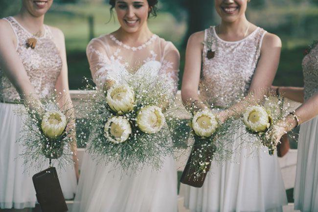 white protea bouquets for bridesmaids