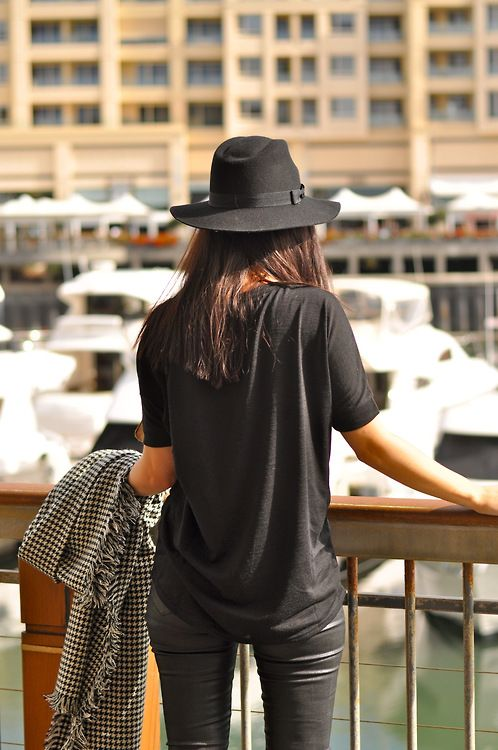 Shop this look for $51:  http://lookastic.com/women/looks/black-hat-and-black-crew-neck-t-shirt-and-black-and-white-scarf-and-black-skinny-pants/2465  — Black Hat  — Black Crew-neck T-shirt  — Black and White Houndstooth Scarf  — Black Leather Skinny Pants