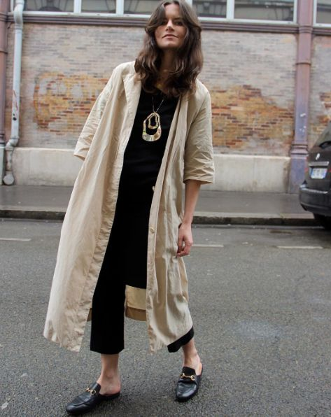 long coat, statement necklace and loafers.
