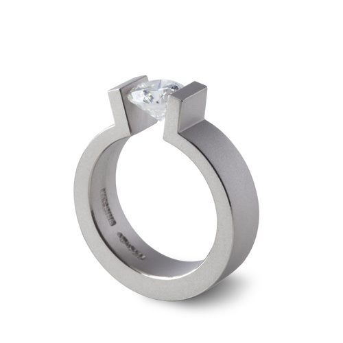 "Niessing ""HighEnd"" tension ring; with open arms, the ring band receives its precious gift. 18k grey gold set with 1.10 ct round brilliant cut diamond. Available from www.davidsonjewels.com"