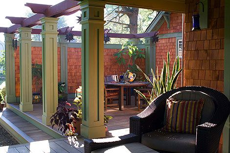 Covered porch opens to the partly enclosed patio deck with a row of columns.
