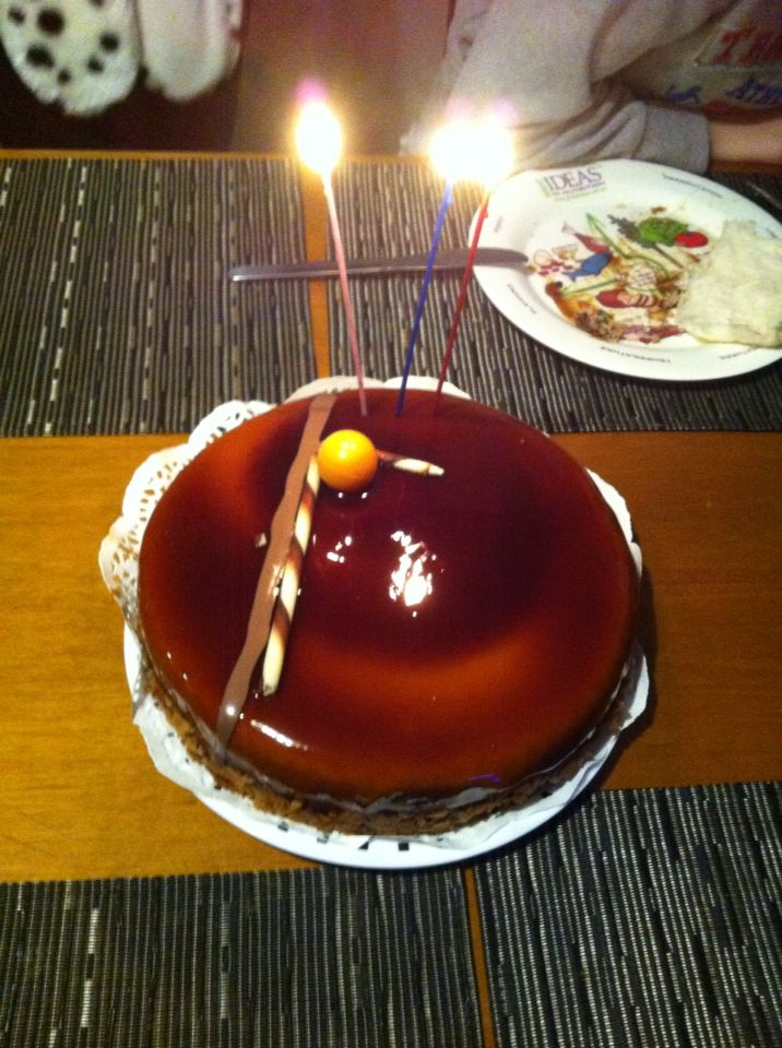 Cake. The orange ball is white chocolate.