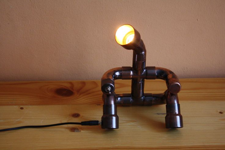 Cute light man. The lamp was made by antiqued copper fittings. It operates from 12 V and 2 W LED bulb is into head. The brightness is low, therefore I recommend for mood lamp. You can light the lamp exc wall, picture, or little statue. The head is rotating. The switch is in hand, the jack is in leg. Does not heat up, and not consume much.