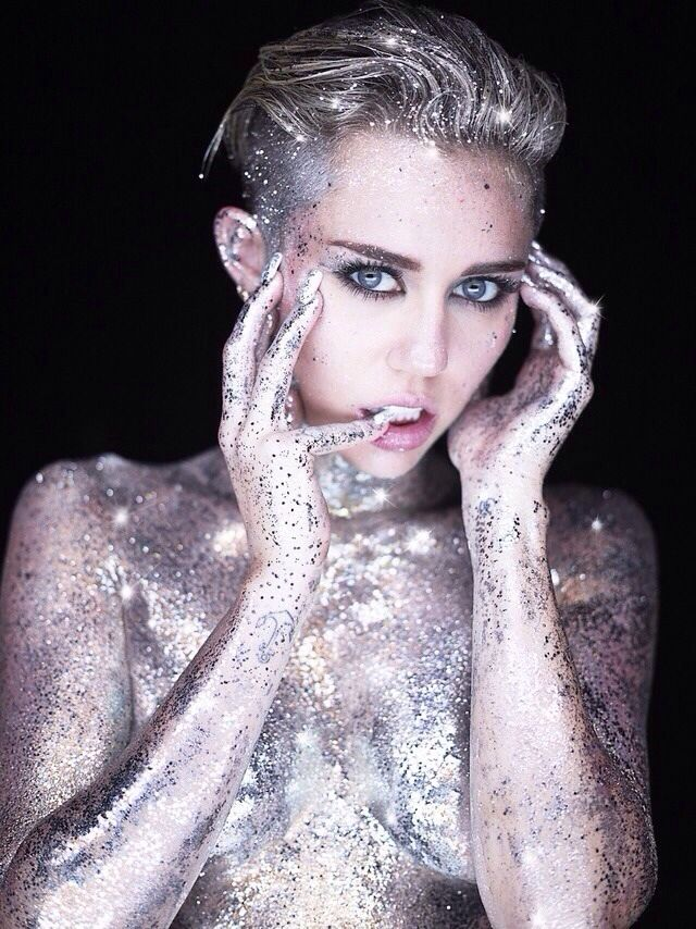 Miley Cyrus By Photographer Rankin - Miley's elf ears and piercing eyes are so high fashion. She wears the glitter, it doesn't wear her.