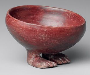 Predynastic Egyptian pot with feet (ca. 3750 BC). I would appreciate any more information on this piece - neither the form nor the glaze look very predynastic Egyptian to me, but of course I can be wrong.