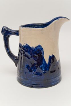Important Frank Haws Western Stoneware Old Sleepy Eye  Blue & White Folk Art Lunch Hour Pitcher Signed FH 1910 »  Circa 1910