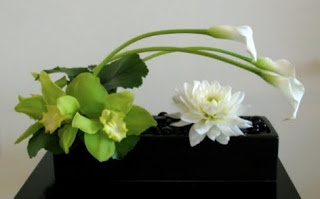 ZWADA home -  contemporary flower arrangement :  cala, cymbidium orchid, dahlia zwadadesign.com