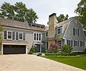 Focus on a Cohesive Exterior: front door overhang mimics garage overhang