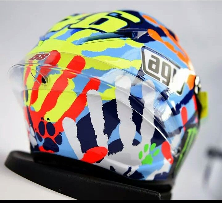 Valentino Rossi's special helmet at Misano Marco simoncelli circuit 2014 Hand prints of his friends and dog and cat! Love it! Also a kiss print from his mum and girlfriend