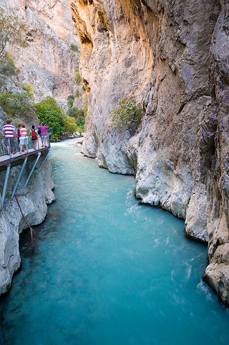 Saklikent gorge, turkey! The coldest, clearest water, towering orange walls, black mud and smooth white limestone to slide down.