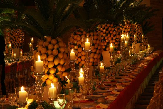 ,The décor at the Granai. Matteo Corvino designed two spectacular long tables, surrounded by colored lanterns and adorned with stunning arrangements of fresh lemons.