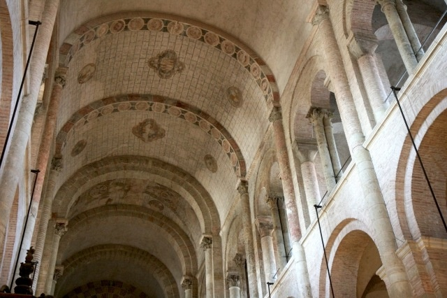 the defining features of romanesque architecture The architects have made free use of the romanesque elements distorting them  to  while this doesn't have the round-headed arches characteristic of the other.