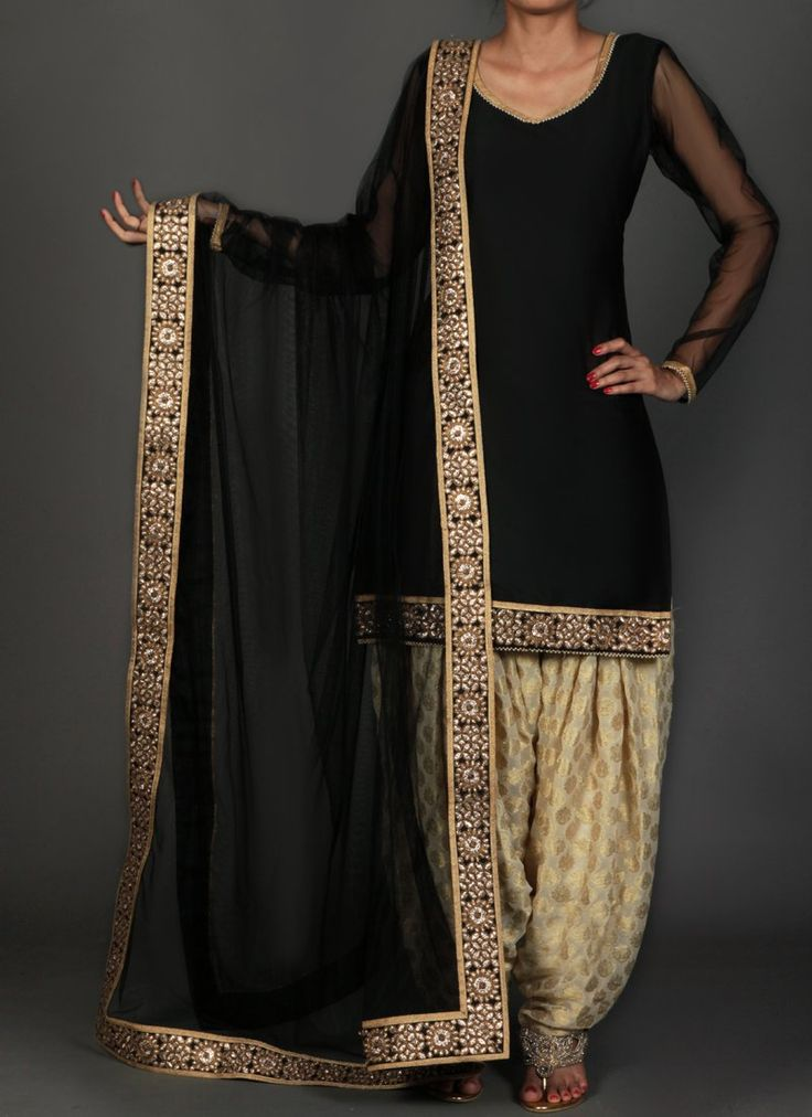 Black and Golden Brocade Punjabi Suit features a taffeta silk kameez with santoon inner, brocade salwar and net dupatta. Embroidery work is completed with lace