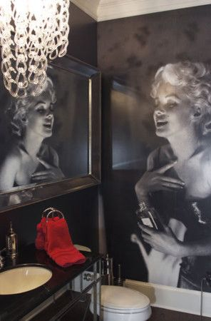 Powder Room - Calling all Marilyn Monroe fans, this one is for you.  Gotta love how the reflection in the mirror is of the photo on the wall.   Chandelier adds the hit of glam while the red is all passion & sexy.  What, in the loo, you say.  Clever clever clever.