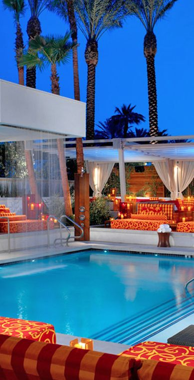 The Pond is an always-buzzing alfresco bar shaded by towering palm trees in Vegas.