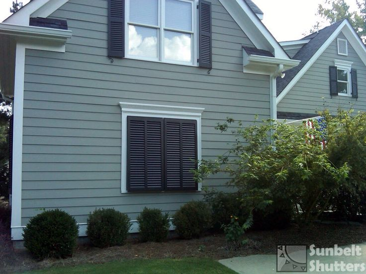Use bahamas shutters to create a faux window on a - Exterior louvered window shutters ...